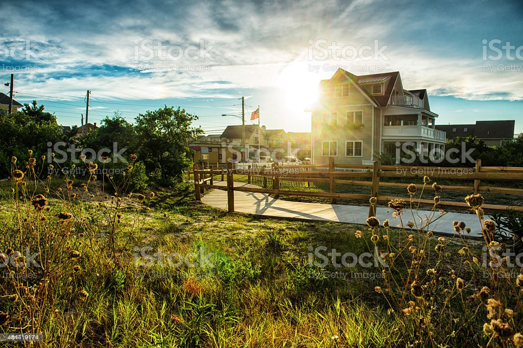 Classical american house with nature around at sunset time stock photo