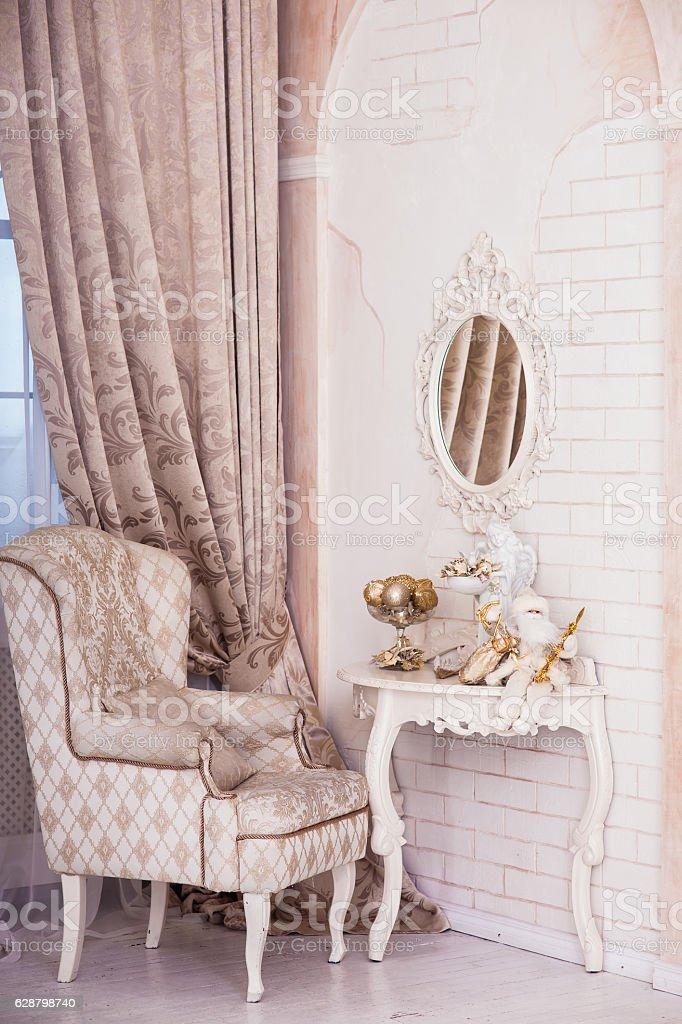 Classical armchair, Christmas Santa sitting on the dressing table. stock photo