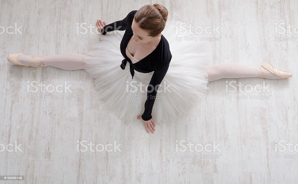 Classical Ballet dancer in split portrait, top view stock photo