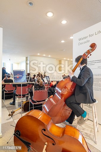 A classical band is performing for tourists in the lobby of UN headquarter in New York City, USA.