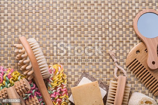 classical bathroom accessories on wicker background with copyspace