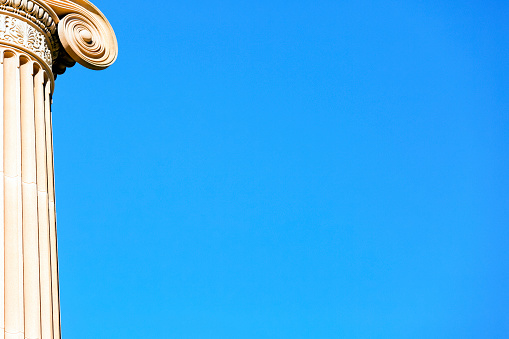 istock Classical Column against blue sky background with copy space 868254420