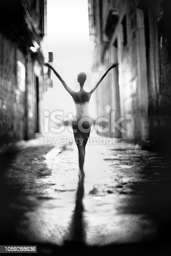 classical dancer dancing at the city street with white dress