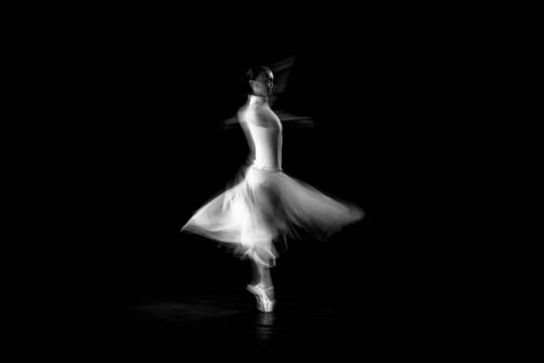 classical dancer dancing on the lack background with white dressed - tiul tkanina zdjęcia i obrazy z banku zdjęć