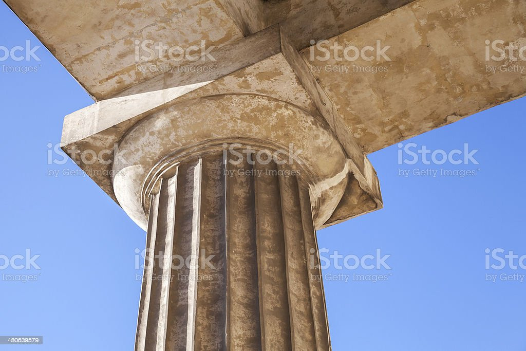Classical Doric order fragment with upper part of column royalty-free stock photo