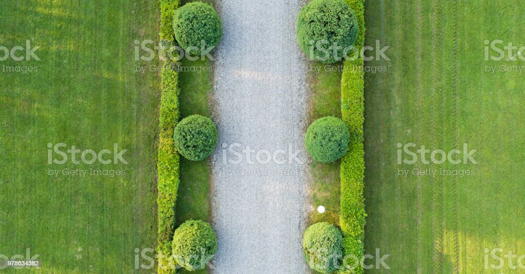 Classical garden road aerial view, photo shot with a drone. Photo...
