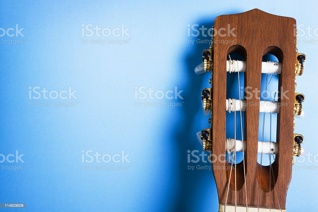 Classical guitar headstock on blue royalty-free stock photo