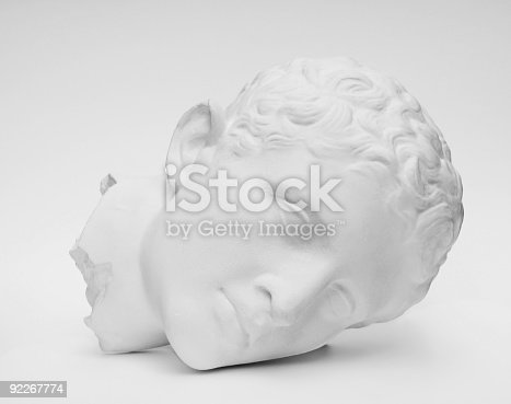 A plaster cast of a classical Roman or Greek statue.  Black and white photograph.