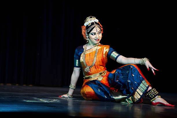 classical indian kuchipudi dancer giving stage performance - classical style stock photos and pictures