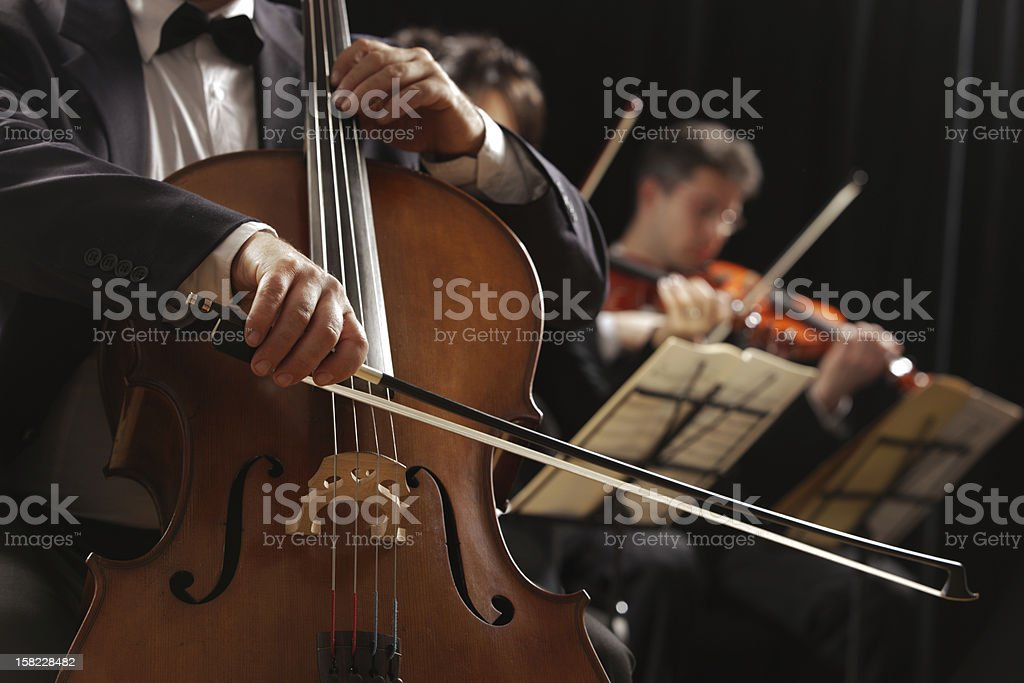 Classical music, cellist and violinists - Royalty-free Adult Stock Photo