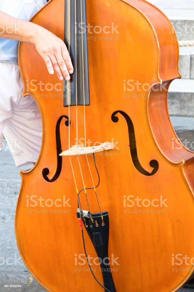 Classical music professional cello player outdoor, hands close up. Vintage cello. stock photo