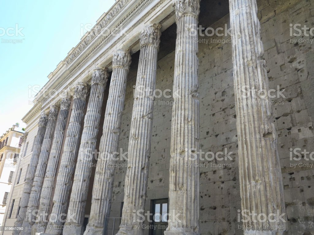 Classical old and worn out columns at the front of the pantheon in Rome stock photo