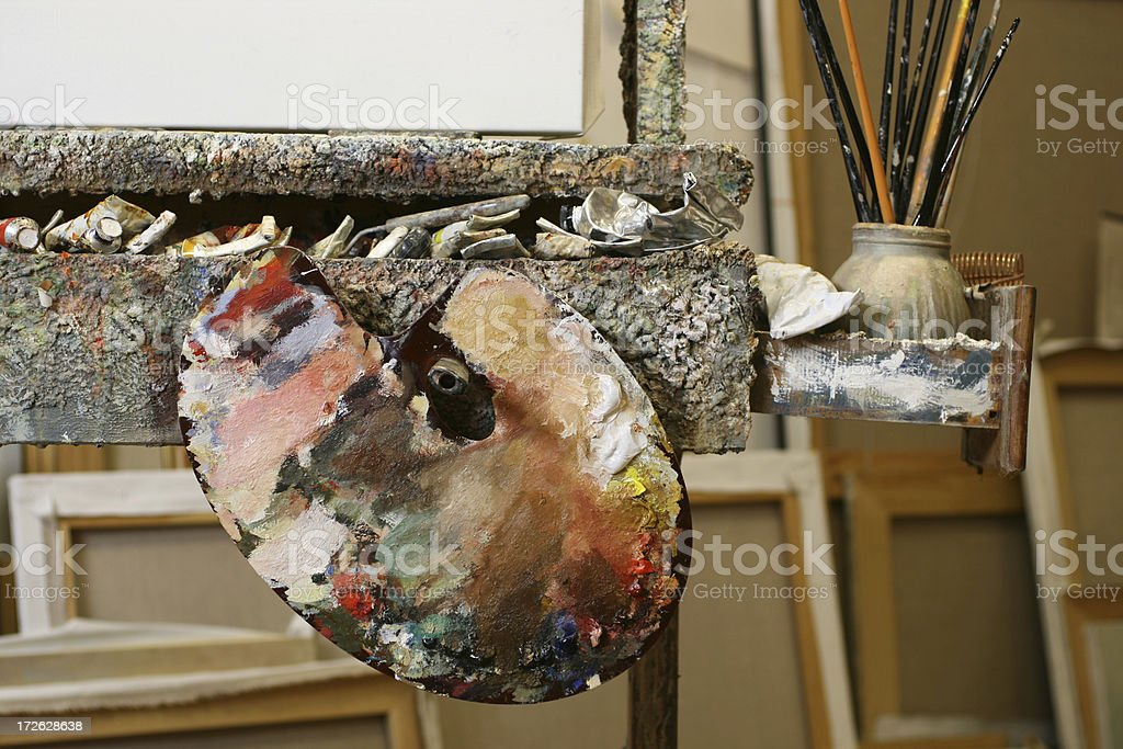 Classical palette with oil colors in the artists studio royalty-free stock photo