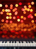 Classical Piano keyboard front view on Christmas lights bokeh background