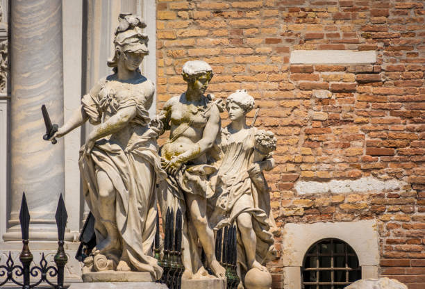 Classical sculptures at the Porta Magna main gate of the Venetian Arsenal, Venice, Italy Classical sculptures at the Porta Magna main gate of the Venetian Arsenal in Venice, Italy. porta magna stock pictures, royalty-free photos & images