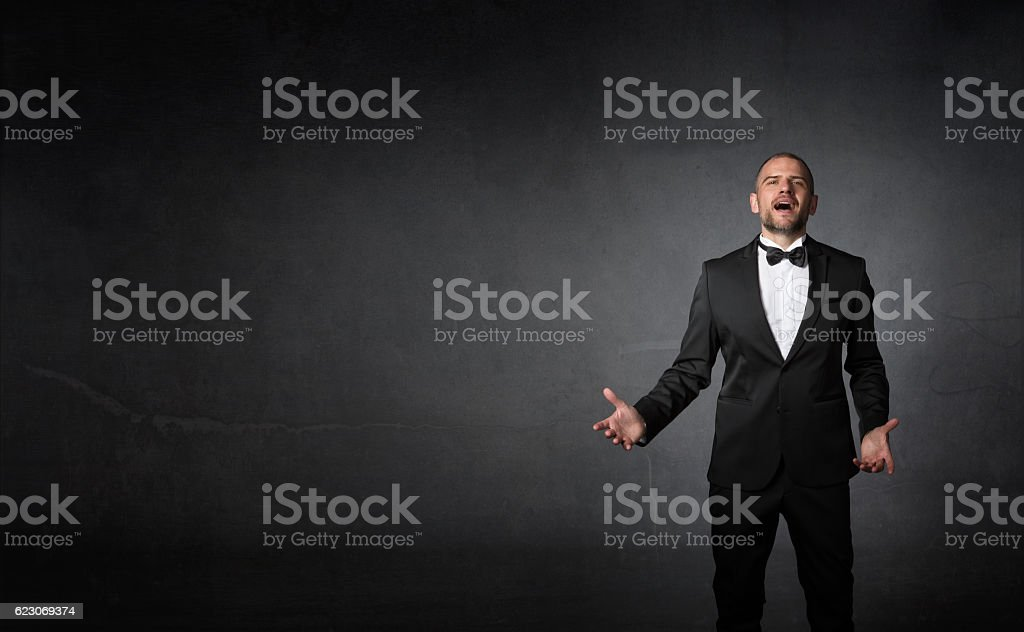 classical singer gestures with hands stock photo