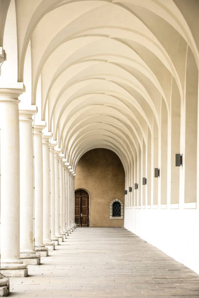 classical style colonnade tunnel - baroque stock photos and pictures
