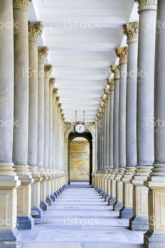 Classical style colonnade with Clock in the middle royalty-free stock photo