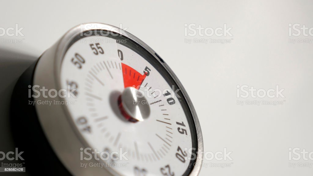 Classical vintage kitchen countdown timer close up, 5 minutes remaining stock photo