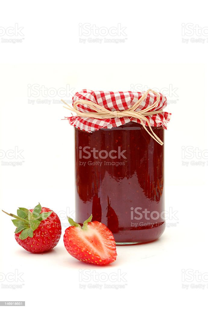 Classically decorated jar of strawberry jam on white stock photo