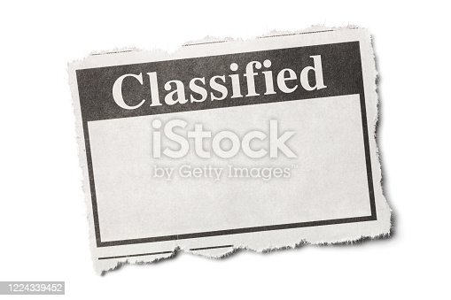 1070355804 istock photo Classified Headline on a Torn Piece of Newspaper with White Background 1224339452
