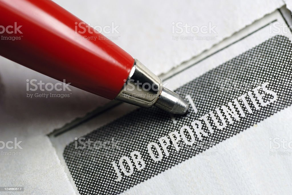 Classified job opportunities with red pen pointing stock photo