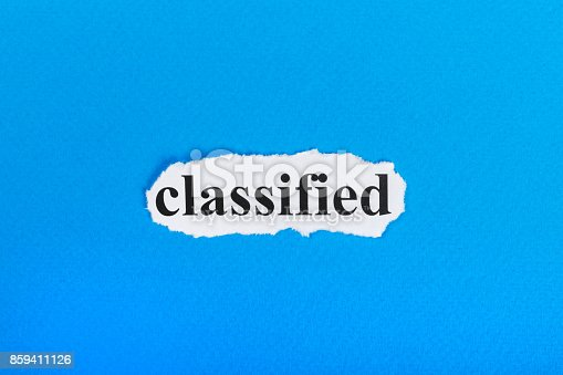 1070355804 istock photo classified text on paper. Word classified on torn paper. Concept Image 859411126