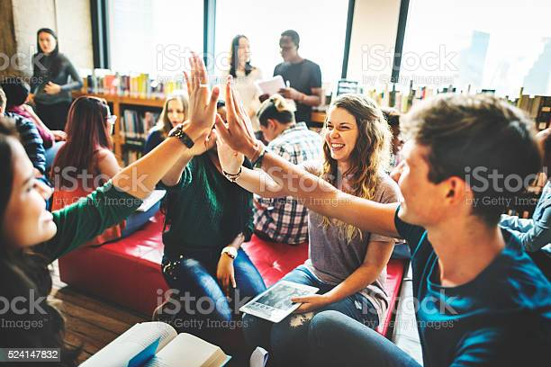 Classmate Classroom Sharing International Friend Concept Stock Photo - Download Image Now
