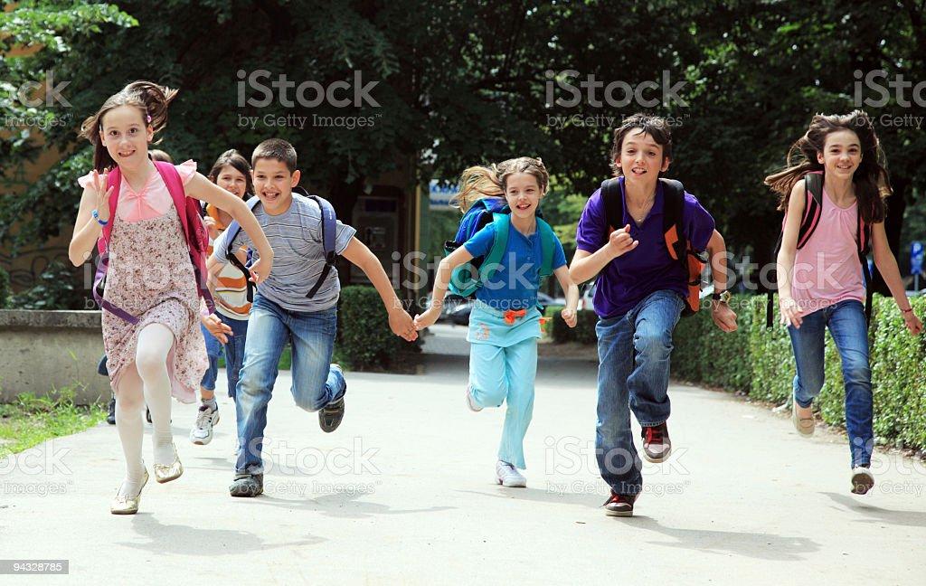 Classmate pupils running outside. royalty-free stock photo