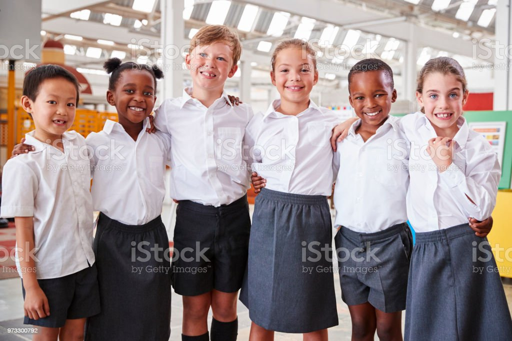 Classmates posing for photo at a science centre royalty-free stock photo