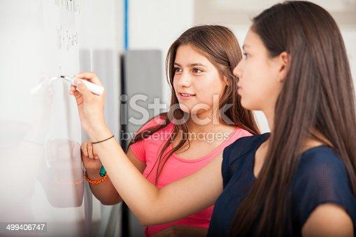 istock Classmates solving a problem 499406747