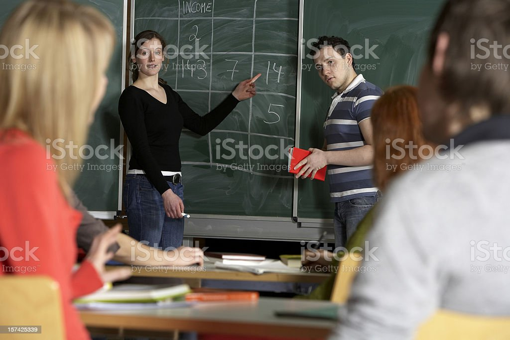 Classrom, students and blackboard royalty-free stock photo
