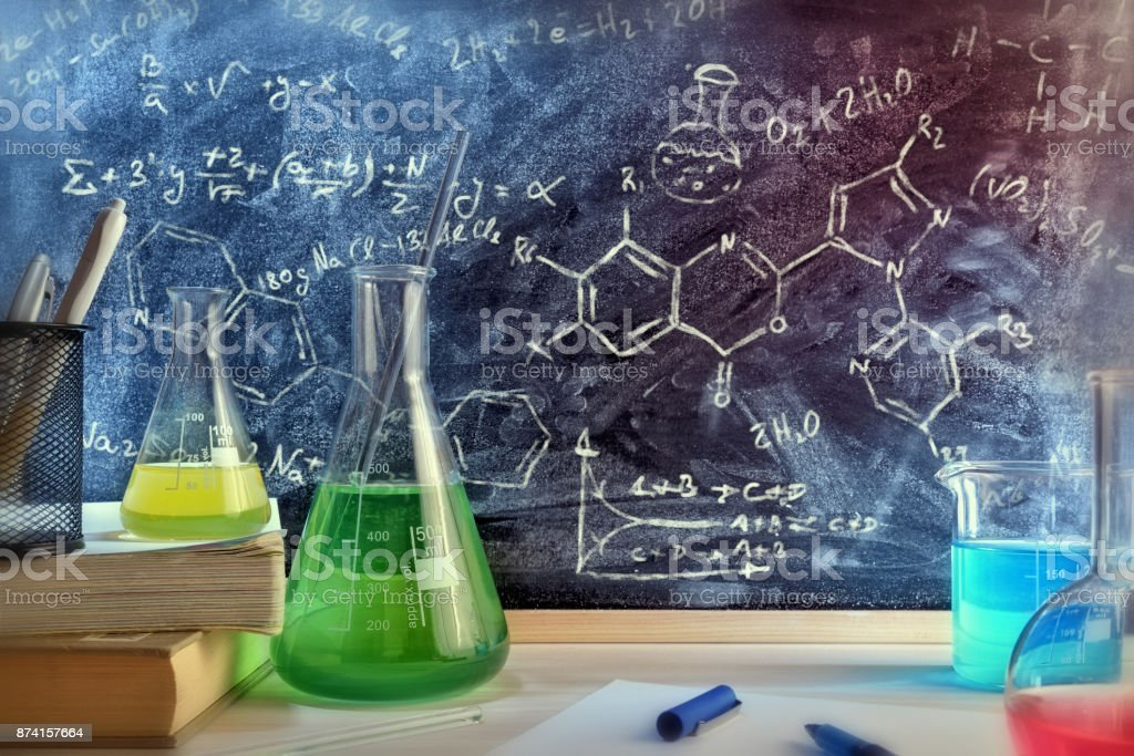 Classroom desk and drawn blackboard of chemistry teaching general view stock photo