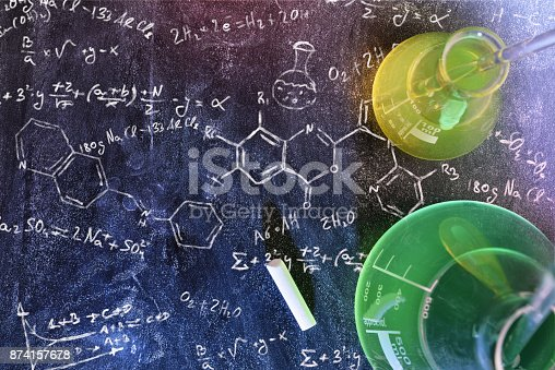istock Classroom desk and drawn blackboard of chemistry teaching top view 874157678