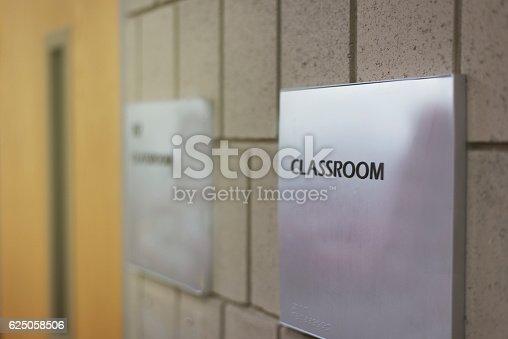 istock Classroom door with sign at school 625058506