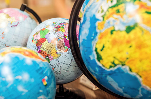 classroom globes - continent geographic area stock photos and pictures