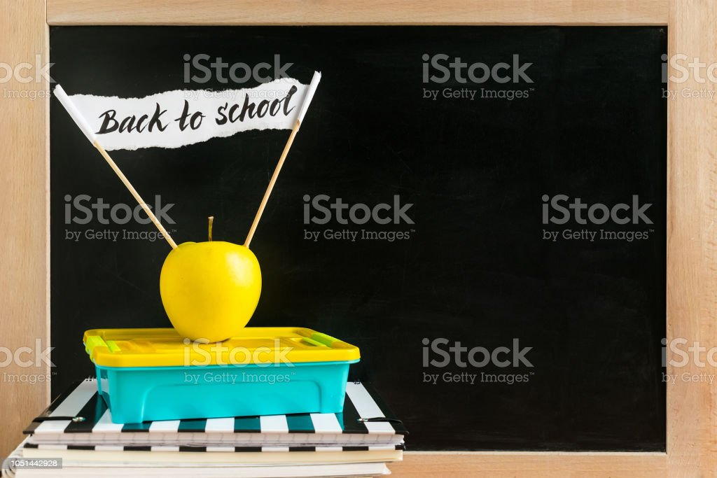 Classroom With Books Notebooks Launch Box And Yellow Apple
