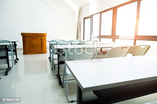 istock Classroom with tables and chairs 879594784
