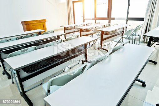istock Classroom with tables and chairs 879594864
