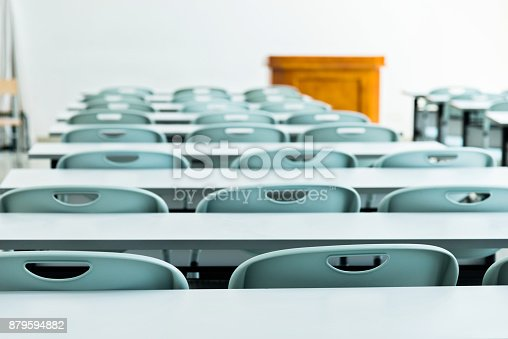 istock Classroom with tables and chairs 879594882