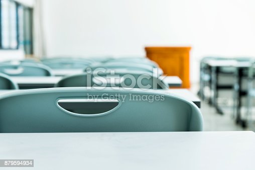 istock Classroom with tables and chairs 879594934