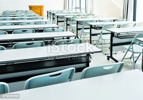 istock Classroom with tables and chairs 879595068