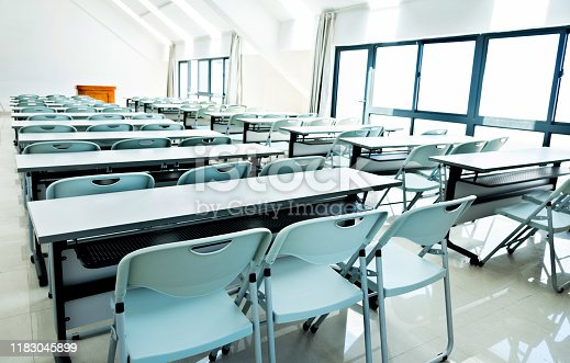 Classroom with white tables and chairs