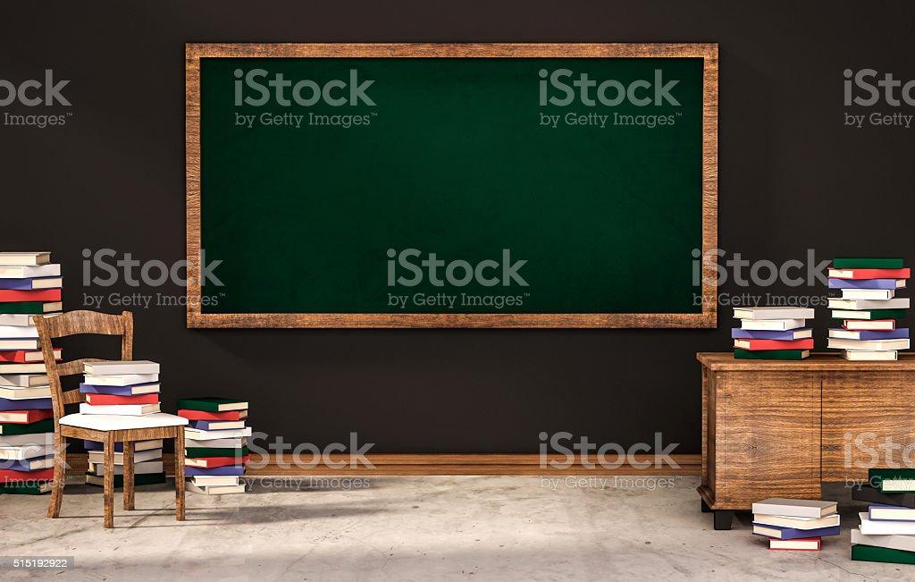Configuration salle de classe tableau sur le mur noir et de nombreux