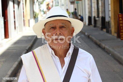 Classy Colombian elder man outdoors.