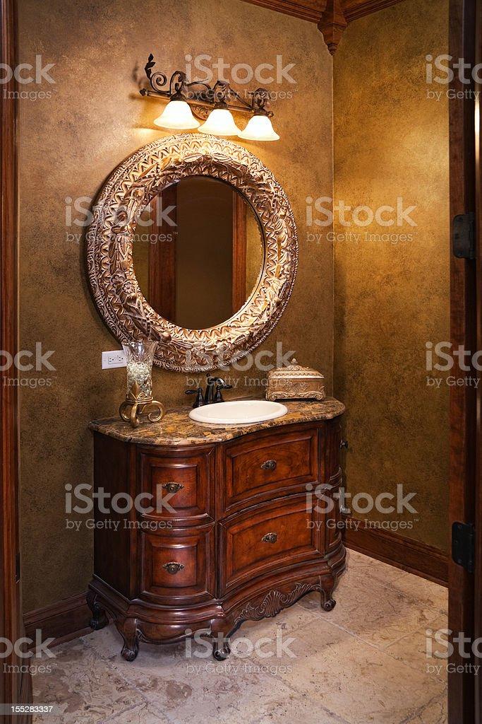 Classy elegant powder room in gold. stock photo