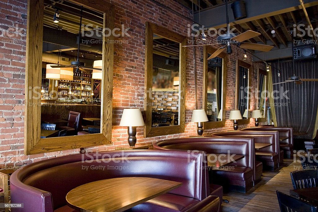 Classy Restaurant Bar With Booths Mirrors And Red Brick
