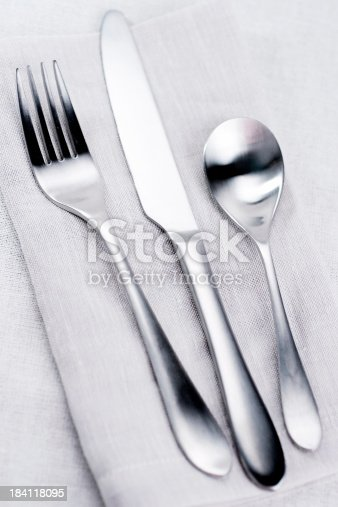 A beautifully simple and classy set of silverware for dining.  Shallow dof.