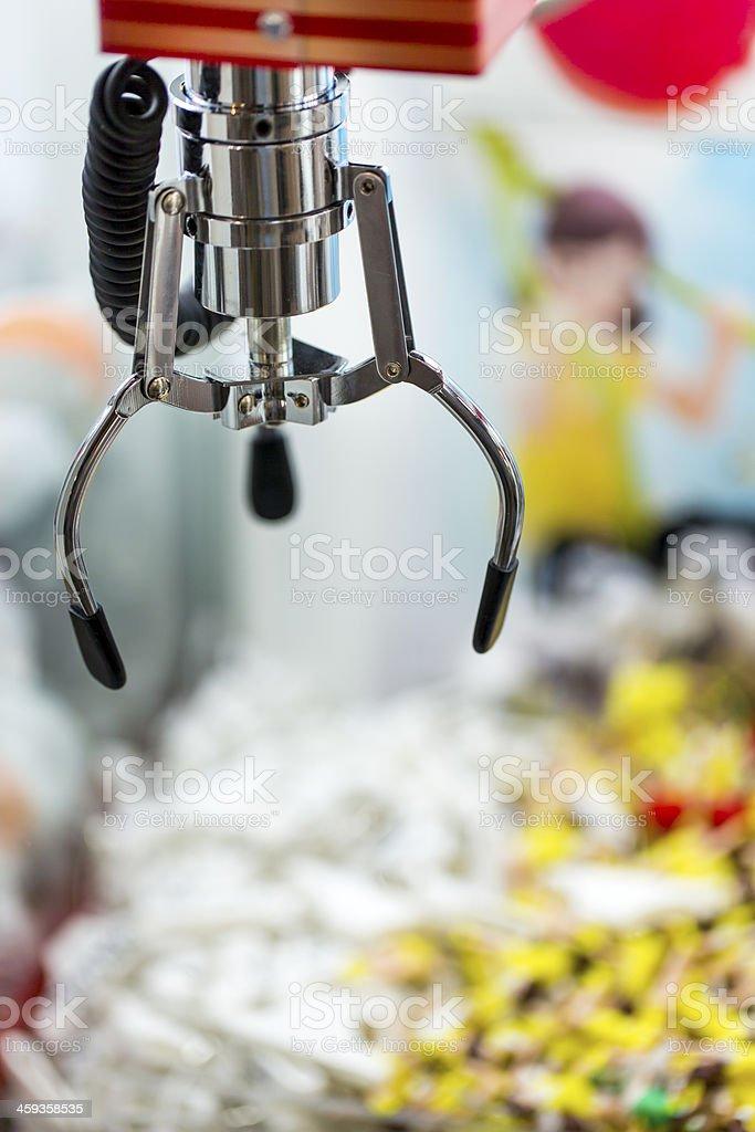 Claw Crane Amusement Game stock photo