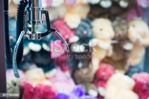 istock Claw crane arcade with toy rewards 922784086